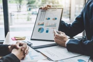 Man sharing analytic data table to support agency relationships